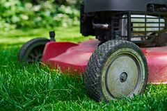 Lawnmower, cutting fresh green gras Royalty Free Stock Images