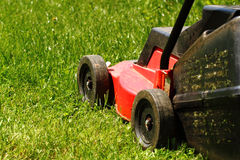 Lawnmower on grass Stock Photo