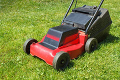 Lawnmower on grass Stock Images