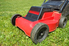 Lawnmower on grass Royalty Free Stock Photography