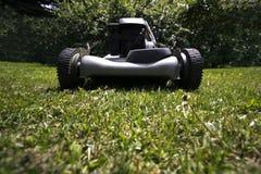 Lawnmower on grass lawn Stock Photos