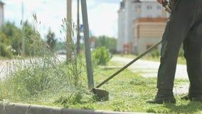 Lawnmower man mows grass to make beautiful design stock video footage