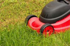 Lawnmower mowing the grass Stock Photo