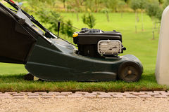 Lawnmower in use. On garden Royalty Free Stock Photo
