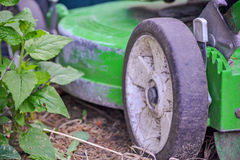 Lawnmower Wheel. Wheel on old green push lawn mower Royalty Free Stock Image