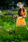 Lawnmower woman in a park Royalty Free Stock Images