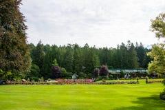 Lawns at Butchart Gardens, Victoria, British Columbia, Canada. Lawns of the Butchart Gardens in Victoria, British Columbia, Canada on sunny day royalty free stock photo