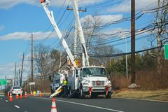 Electricians repairing wire of the power line. Lawrence, New Jersey, USA, March 16 2019:electricians repairing wire of the power line stock images