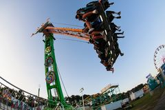 Teenagers Enjoy Speed And Height Of Ride At County Fair Royalty Free Stock Photos