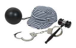 Laws and Consequences. Shown by a gavel and handcuffs with a jailbird hat and ball and chain - path included stock images