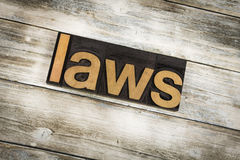Laws Letterpress Word on Wooden Background. The word `laws` written in wooden letterpress type on a white washed old wooden boards background royalty free stock images