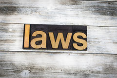 Laws Letterpress Word on Wooden Background. The word `laws` written in wooden letterpress type on a white washed old wooden boards background stock photos