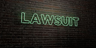 LAWSUIT -Realistic Neon Sign on Brick Wall background - 3D rendered royalty free stock image Royalty Free Stock Photos