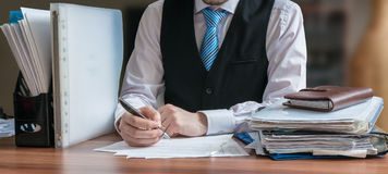 Lawyer is analysing contract in office.  stock photography