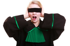 Lawyer attorney in classic polish gown covering eyes with blindfold Royalty Free Stock Photos