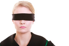 Lawyer attorney in classic polish gown covering eyes with blindfold Stock Photos