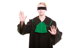 Lawyer attorney in classic polish gown covering eyes with blindfold Royalty Free Stock Image