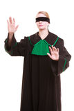 Lawyer attorney in classic polish gown covering eyes with blindfold Royalty Free Stock Photography