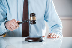 Lawyer or auctioneer raising his gavel. Lawyer, judge or auctioneer raising his wooden gavel to pass judgement or knock down a sale to the highest bidder, close Stock Images