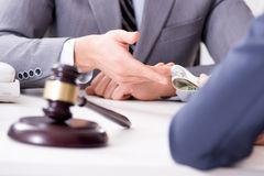 The lawyer being offered bribe for his services. Lawyer being offered bribe for his services Stock Photos