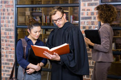 Lawyer and businesswoman reading law book Stock Images