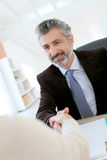 Lawyer and client handshaking Royalty Free Stock Photos