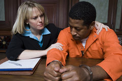 Lawyer Consoling Criminal Stock Images