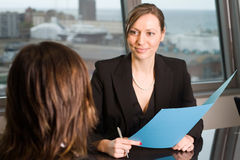 Lawyer consultation in an sky office. Two business women in an office royalty free stock images