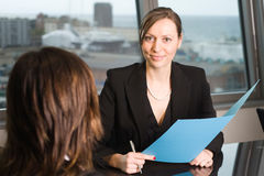 Lawyer consultation in an sky office. Two business women in an office stock photos