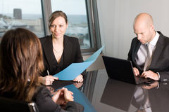 Lawyer consultation in an sky office. Two business women in an office stock photography