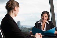 Lawyer consultation in an sky office. Two women in an office royalty free stock images
