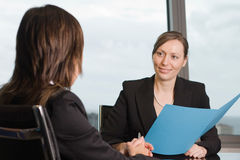 Lawyer consultation in an sky office. Two women in an office stock images
