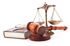 A lawyer in court. Gavel, scales, book and glasses on a white background Stock Image