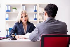 The lawyer discussing legal case with client. Lawyer discussing legal case with client stock photography