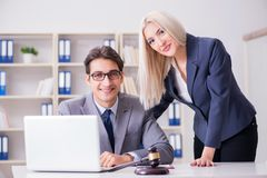 The lawyer discussing legal case with client. Lawyer discussing legal case with client royalty free stock image