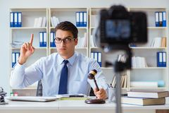 The lawyer doing legal webcast for channel subscribers Royalty Free Stock Photo