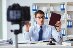 The lawyer doing legal webcast for channel subscribers Stock Image