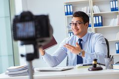 The lawyer doing legal webcast for channel subscribers Royalty Free Stock Images