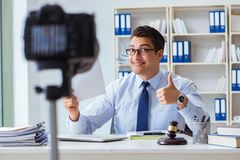 The lawyer doing legal webcast for channel subscribers Stock Images