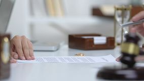 Lawyer explaining woman marriage contract statement before signing document. Stock footage stock footage