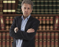 Lawyer in front of bookcase Stock Images