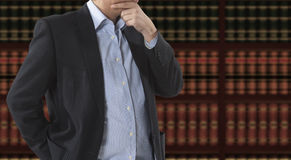 Lawyer in front of bookcase Royalty Free Stock Photography