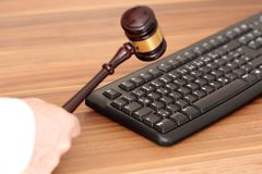 Lawyer with gavel and keyboard Royalty Free Stock Photos
