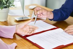 People signing contract stock photo