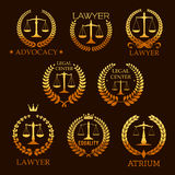 Lawyer golden emblem set with scale of justice. Lawyer office, law firm and legal center golden emblem set. Scale of justice gold symbol, framed by laurel and Royalty Free Stock Photo