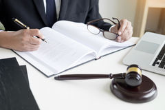 Lawyer hand writes the document in court & x28;justice, law& x29; with sou. Nding block Stock Photo