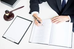 lawyer hand writes the document in court & x28;justice, law& x29; with sou