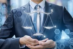 Lawyer in the hands shows the scales. stock photography