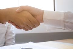 Lawyer handshake. Lawyer people shaking hands with client, finishing up a meeting,Success agreement negotiation.  royalty free stock photo