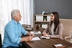 Lawyer having meeting with senior client